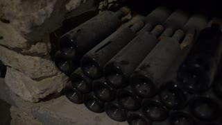 old-wine-bottles-nestled-in-dust-in-the-winery-cellar_bsfpfv9axe_thumbnail-small01